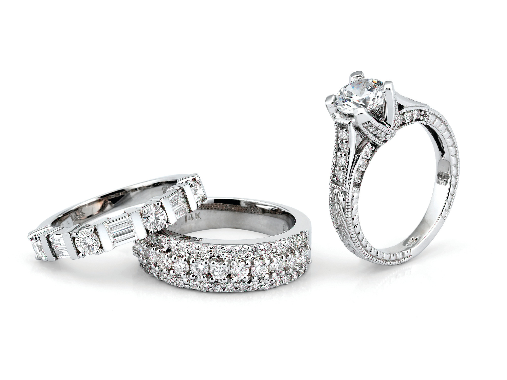 Beautiful Diamond Eternity Bands along with an Engagement Ring on white background.