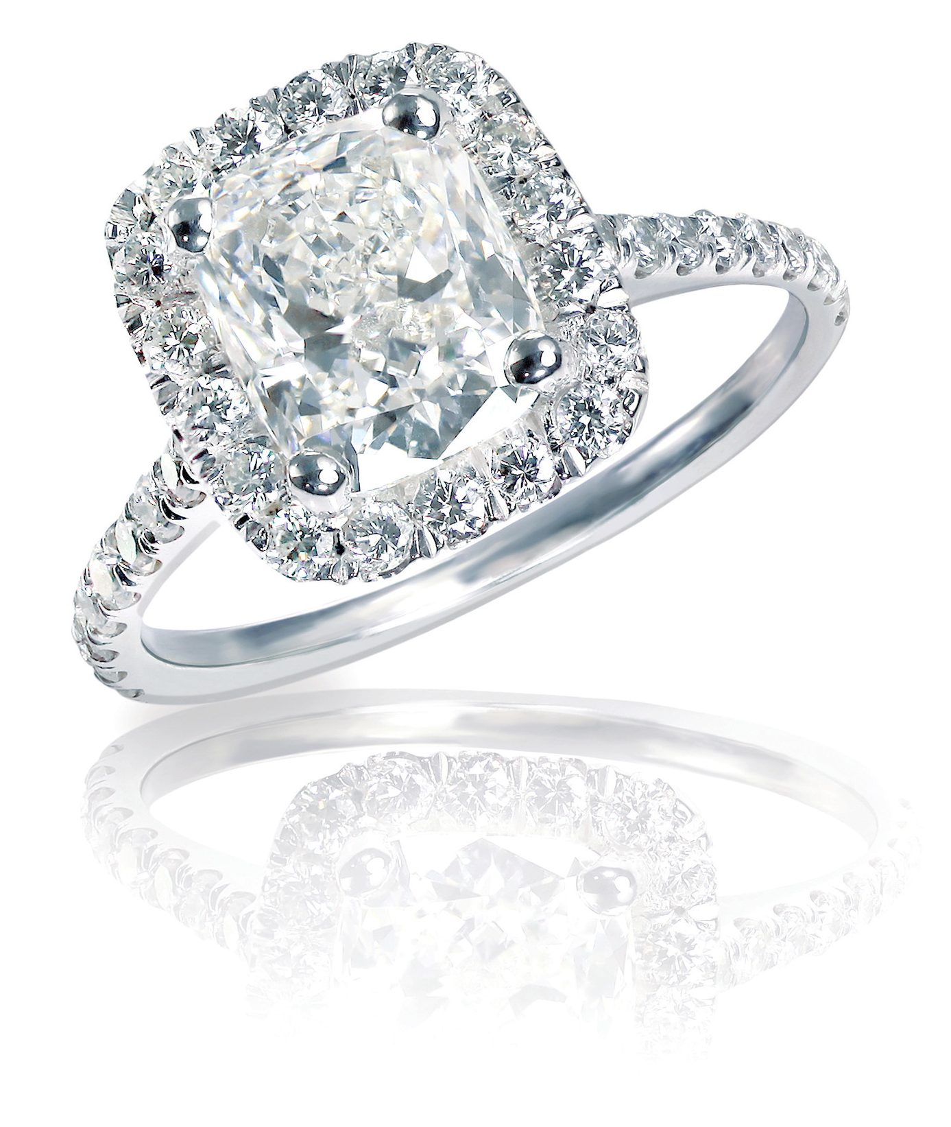 Large cushion cut, sapphire emerald cut, diamond surrounded by smaller diamonds on a modern halo setting.