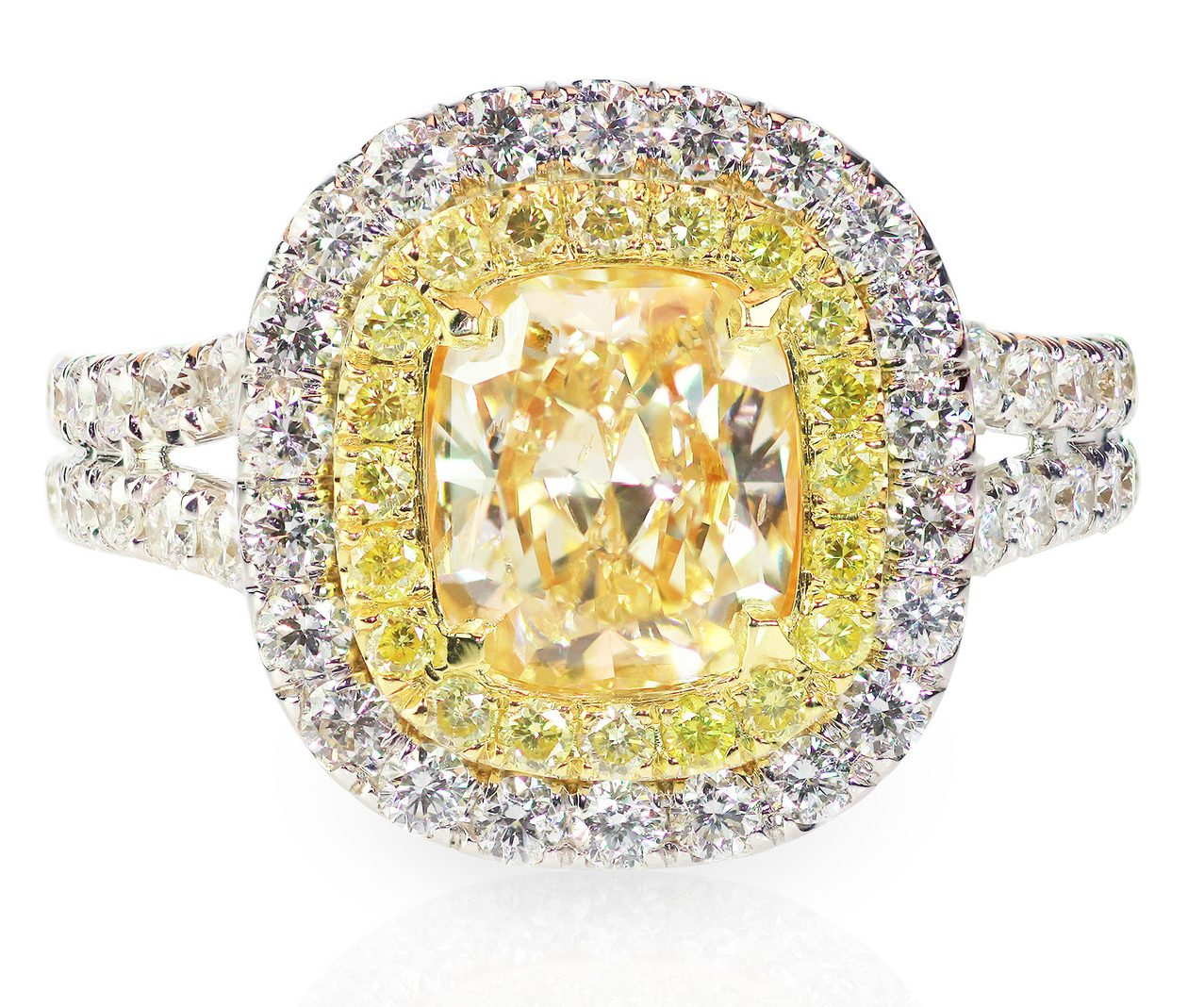 Three tone yellow canary diamond engagement ring with a double halo setting.